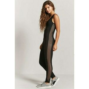NWT Activewear black jumpsuit w/mesh. Size medium.